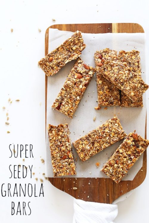 Parchment-lined cutting board of Super Seedy Granola Bars