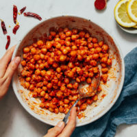 Spoon in a bowl of Harissa Chickpeas