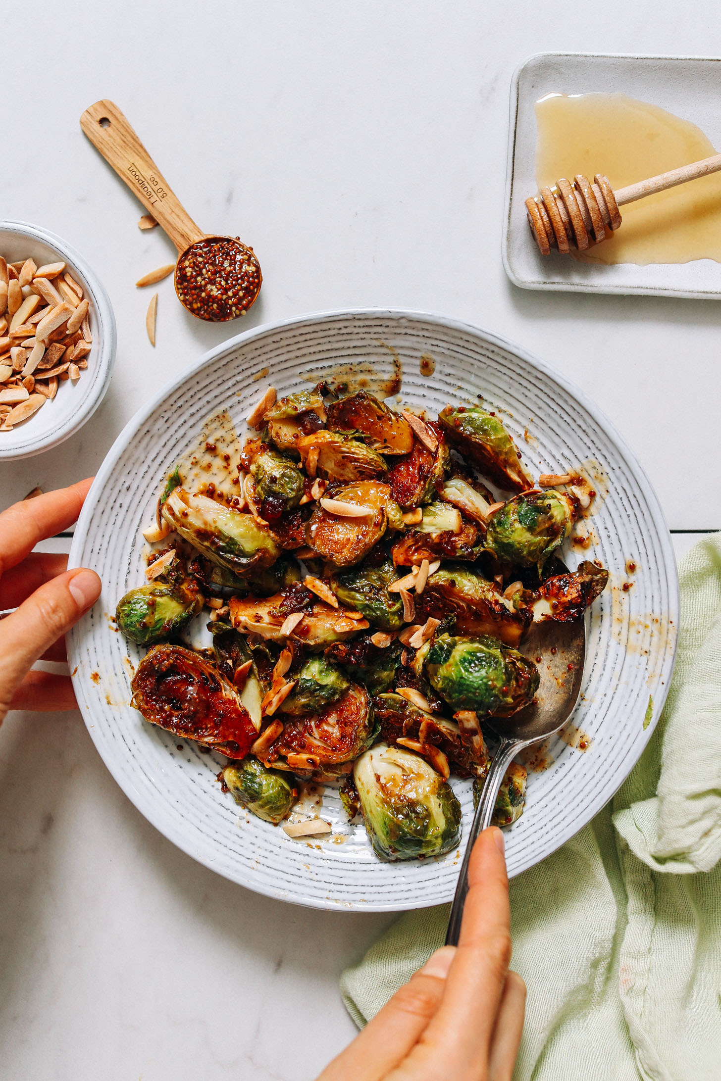 Bowl of Roasted Brussels with honey mustard glaze and toasted almonds