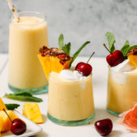 Glasses of a refreshing pina colada smoothie
