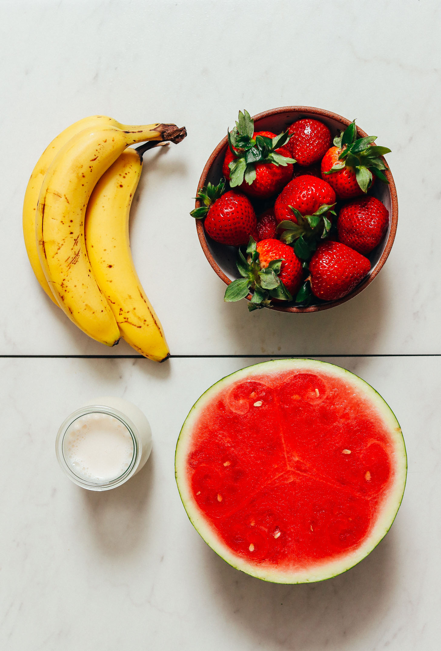 Bananas, strawberries, watermelon, and almond milk