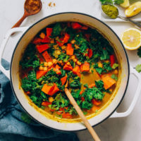 Dutch oven filled with Chickpea Sweet Potato Kale Green Curry