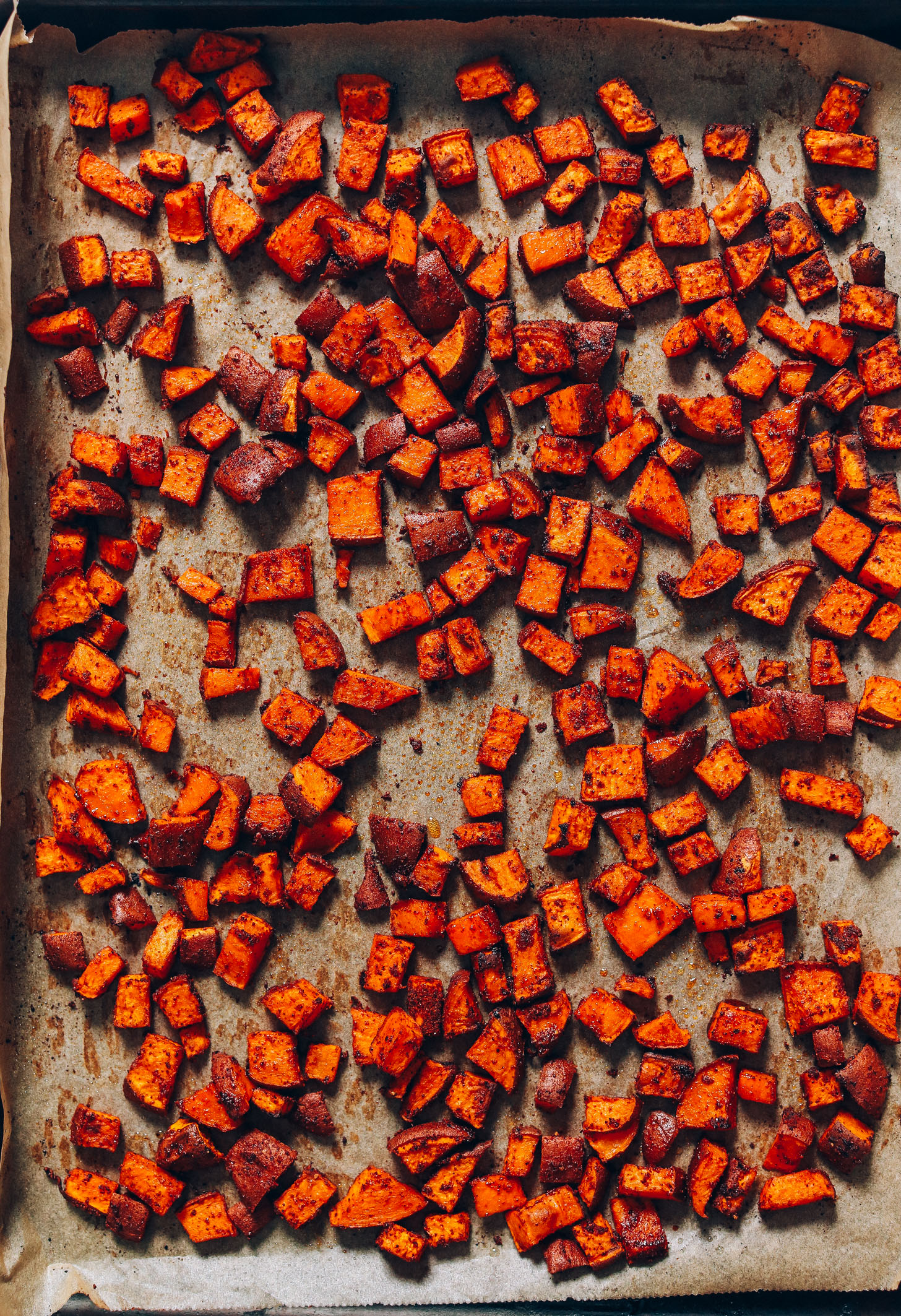 Baking sheet of tender Roasted Sweet Potato Croutons with BBQ seasonings