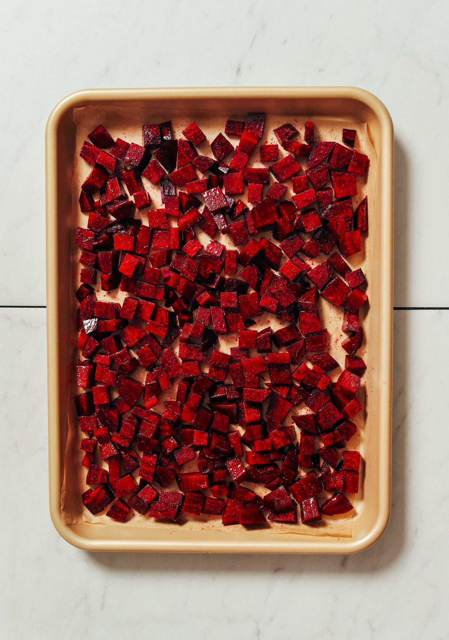 Baking sheet of cubed beets with seasonings