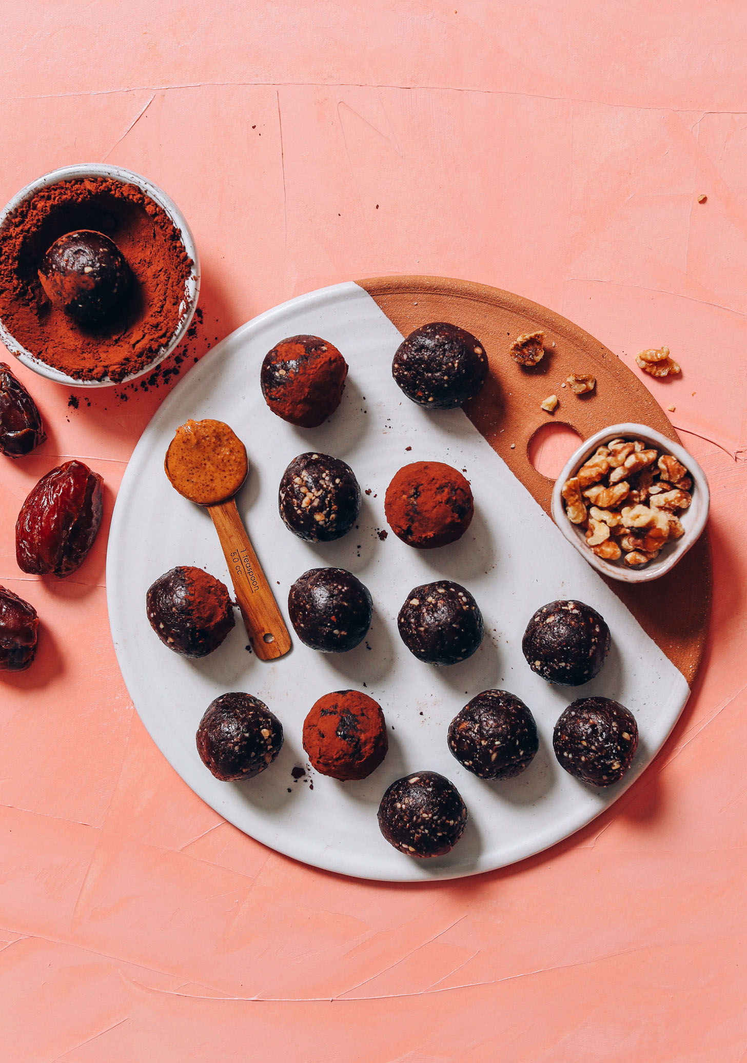 Dates, almond butter, cacao, and walnuts next to a tray of Vegan Brownie Bites