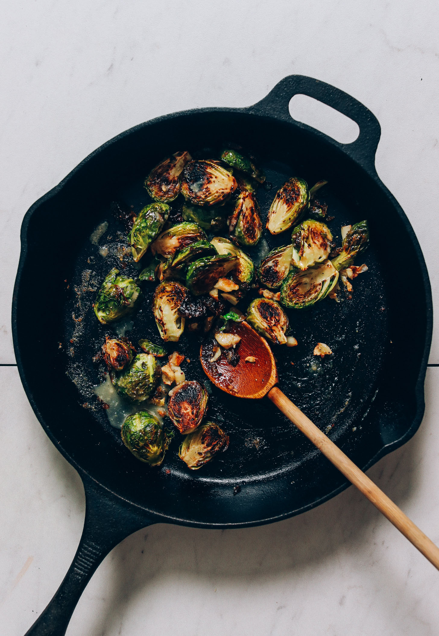 Cast iron pan of crispy miso brussels sprouts