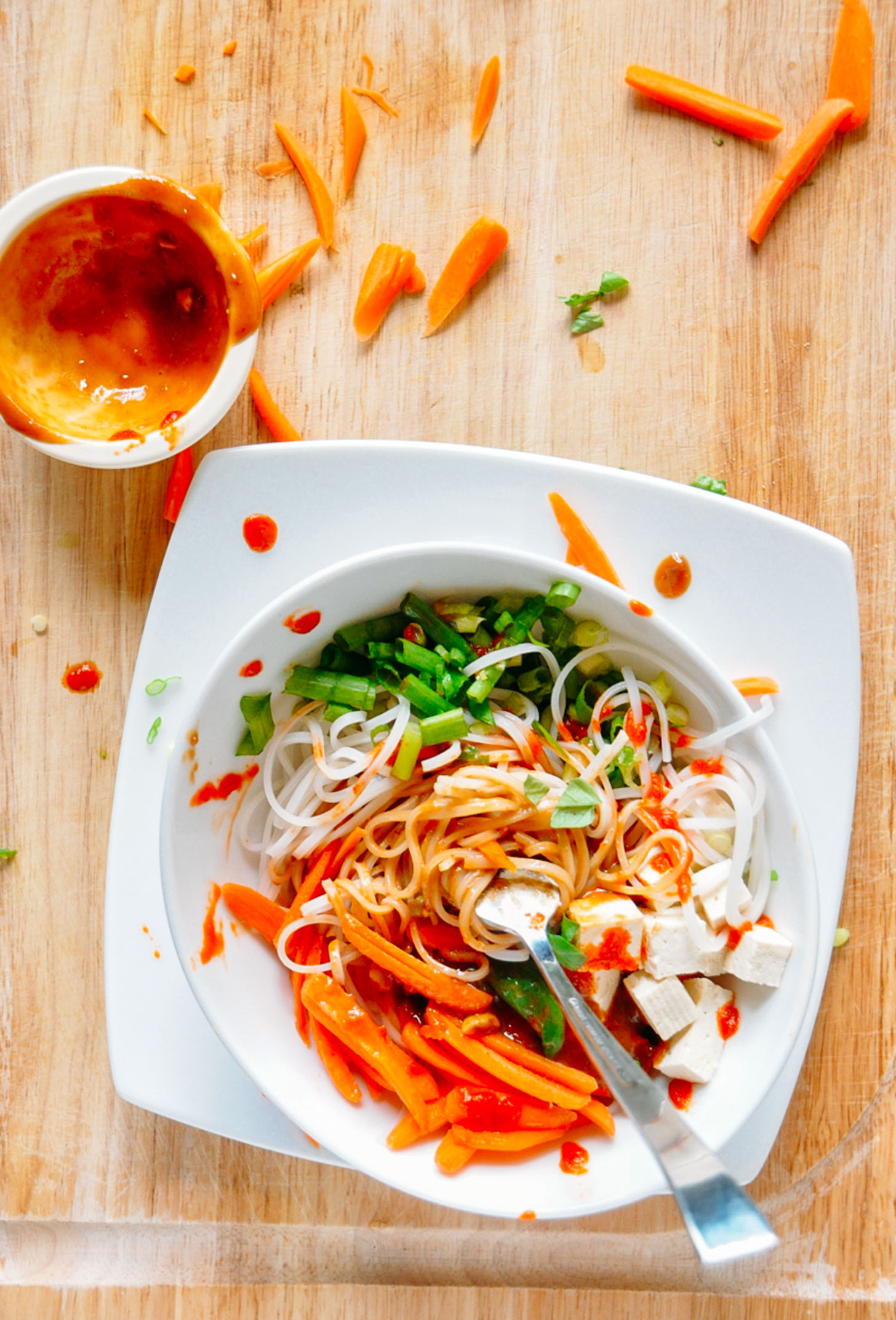 Overhead image of a veggie rice noodle bowl with ginger peanut dressing for minimalist baker
