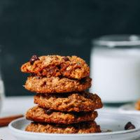 Stack of Pumpkin Chocolate Chip Cookies next to dairy-free milk