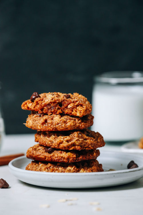 Stack of Pumpkin Chocolate Chip Cookies next to dairy-free milk