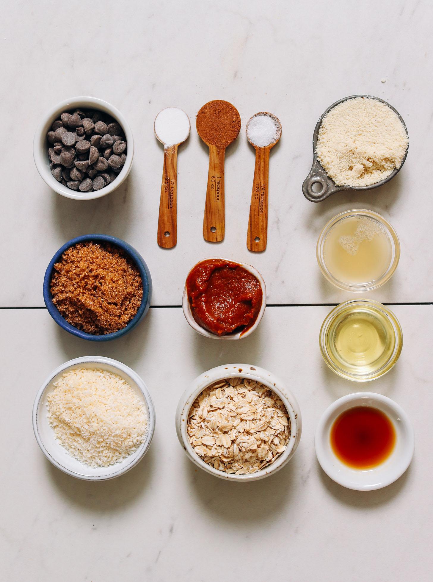 Vegan chocolate chips, baking powder, pumpkin pie spice, salt, almond flour, aquafaba, avocado oil, vanilla, oats, pumpkin butter, brown sugar, and shredded coconut