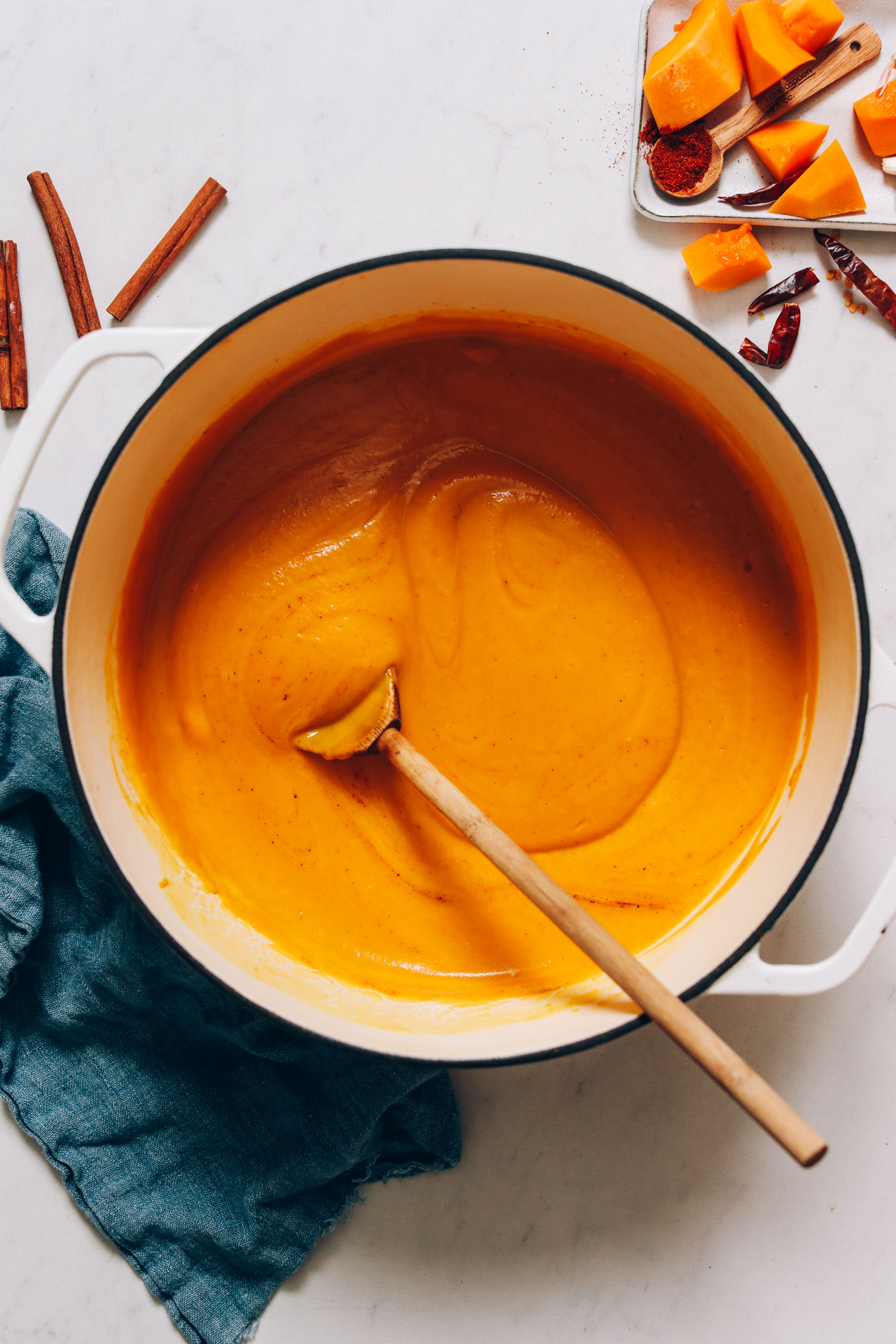 Pot of creamy carrot and butternut squash soup