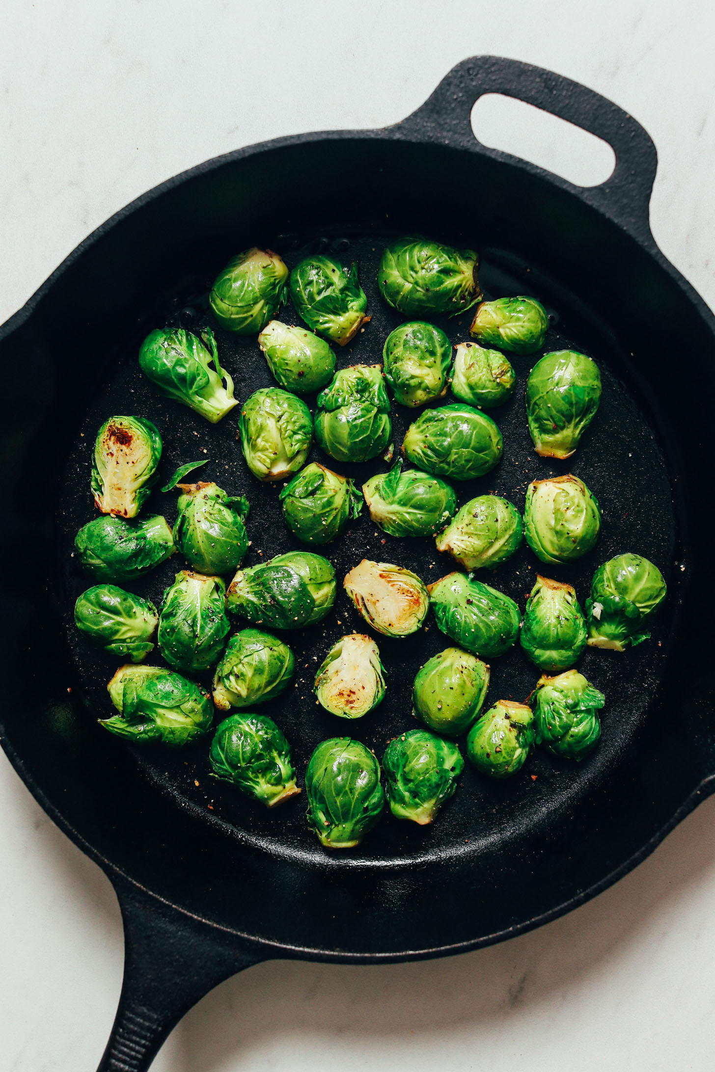 Searing Brussels sprouts in a cast iron skillet