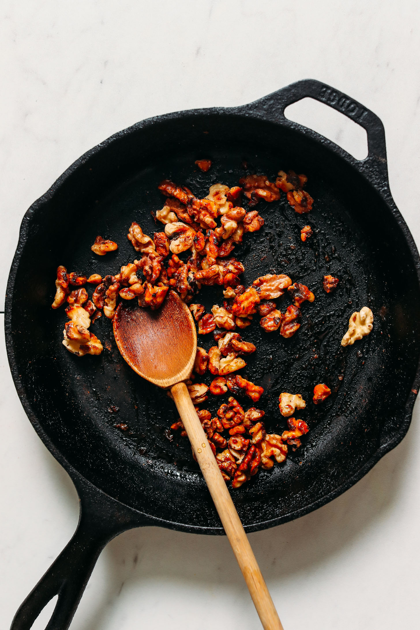 Toast the nuts in a cast iron pan