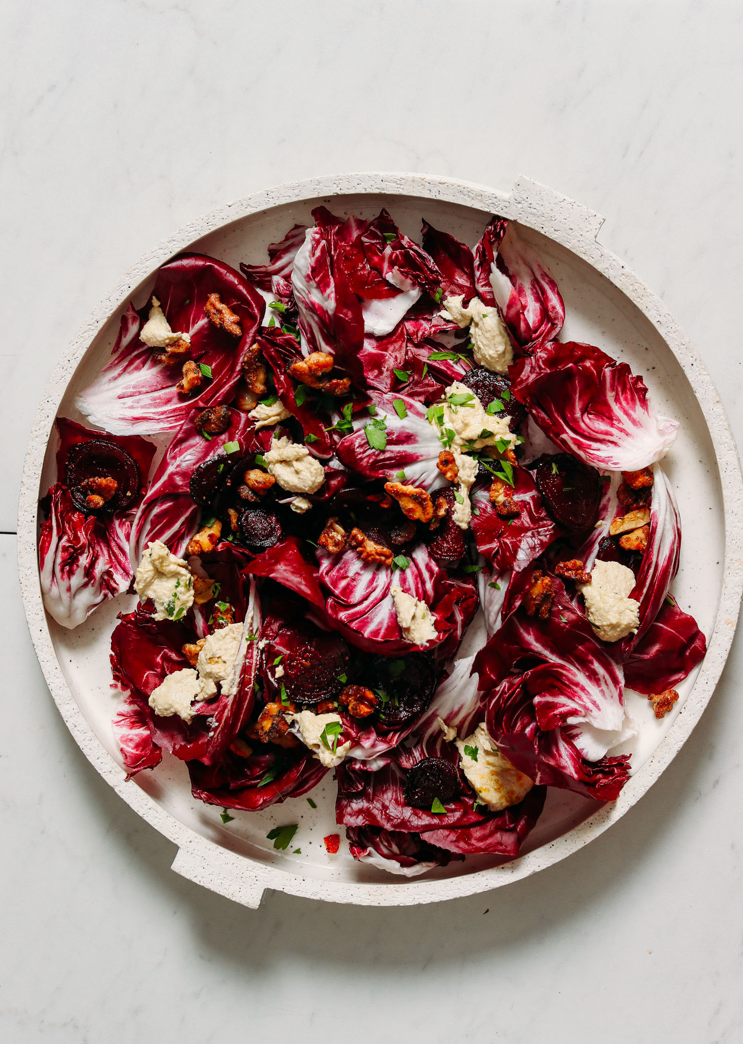 Plate of radicchio salad with roasted beets, garlic and lemony cashew ricotta vinaigrette