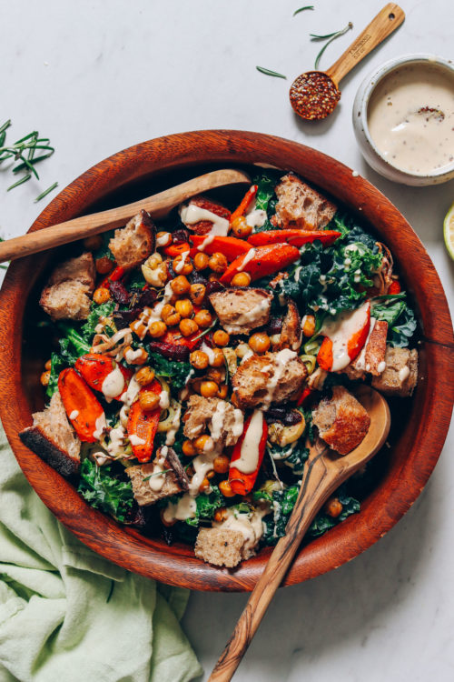 Wood bowl of our Fall Vegetable Panzanella made with tahini dressing