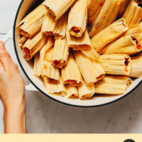 Holding a Dutch oven filled with homemade tamales