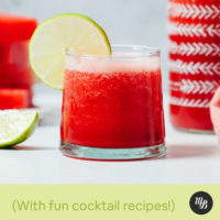Glass of watermelon juice with a lime slice on the rim