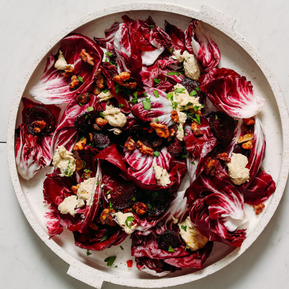 Platter of radicchio salad with candied walnuts, beets, and dressing