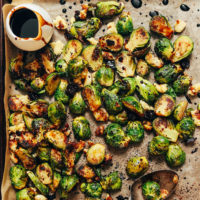 Baking sheet of Crispy Roasted Brussels Sprouts with Balsamic Reduction