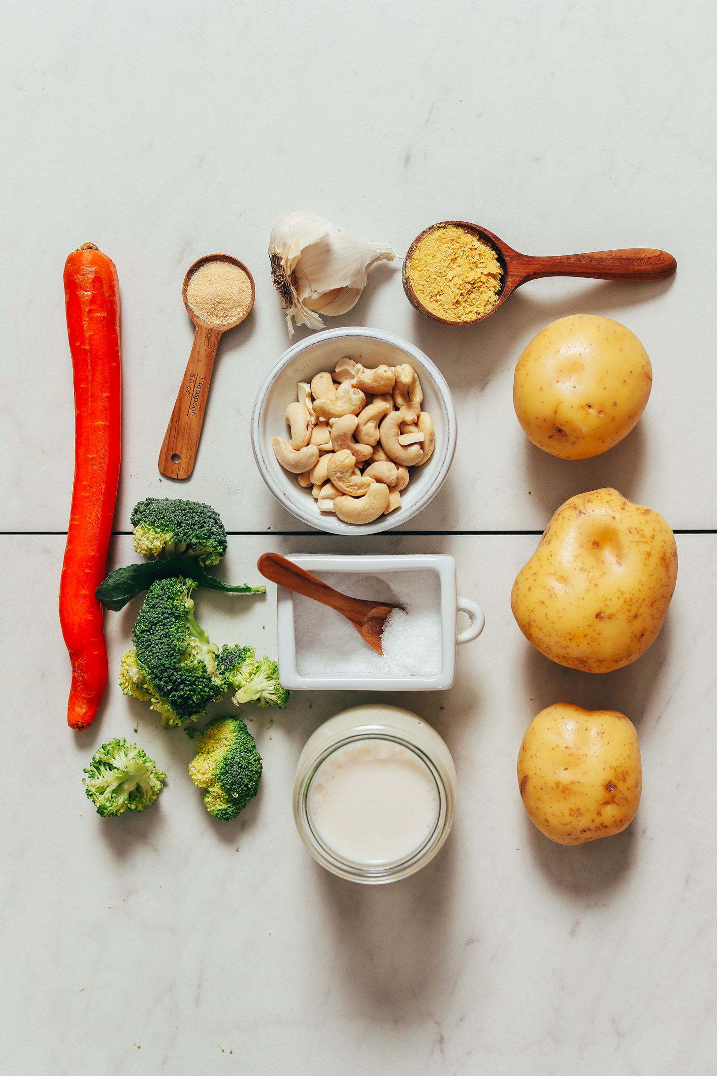 Carrot, broccoli, dairy-free milk, salt, cashews, garlic powder, garlic, nutritional yeast, and gold potatoes