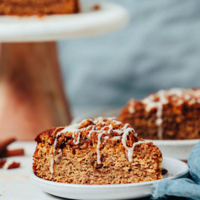 Cake stand and plate with slices of vegan gluten-free coffee cake