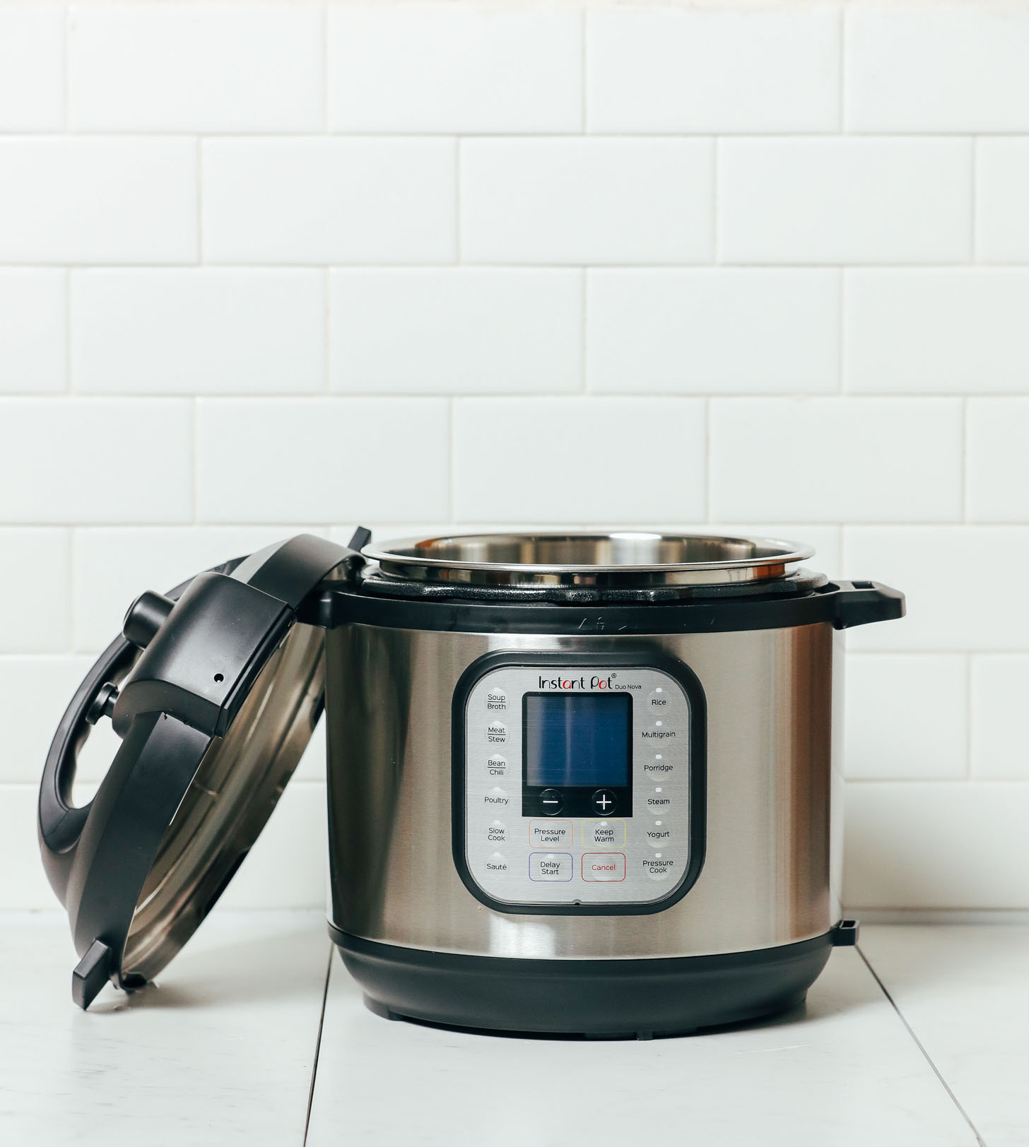 Open Instant Pot with lid resting against the base