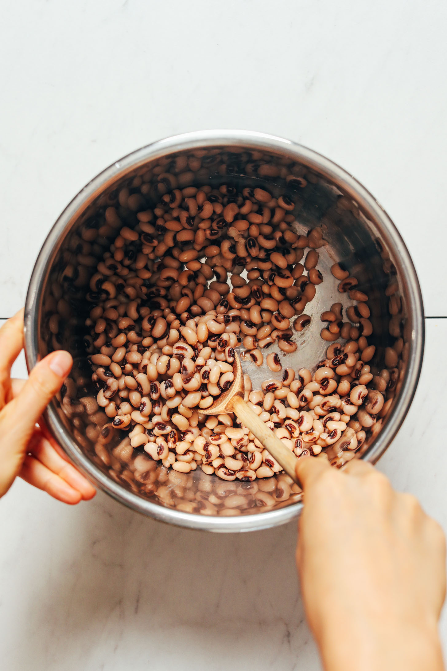 Stirring cooked black eyed peas in the Instant Pot