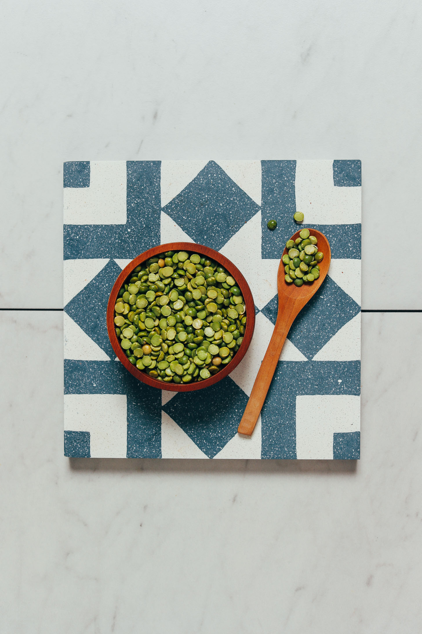 Bowl and spoonful of dry green split peas