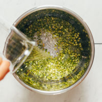 Pouring water into an Instant Pot of green split peas