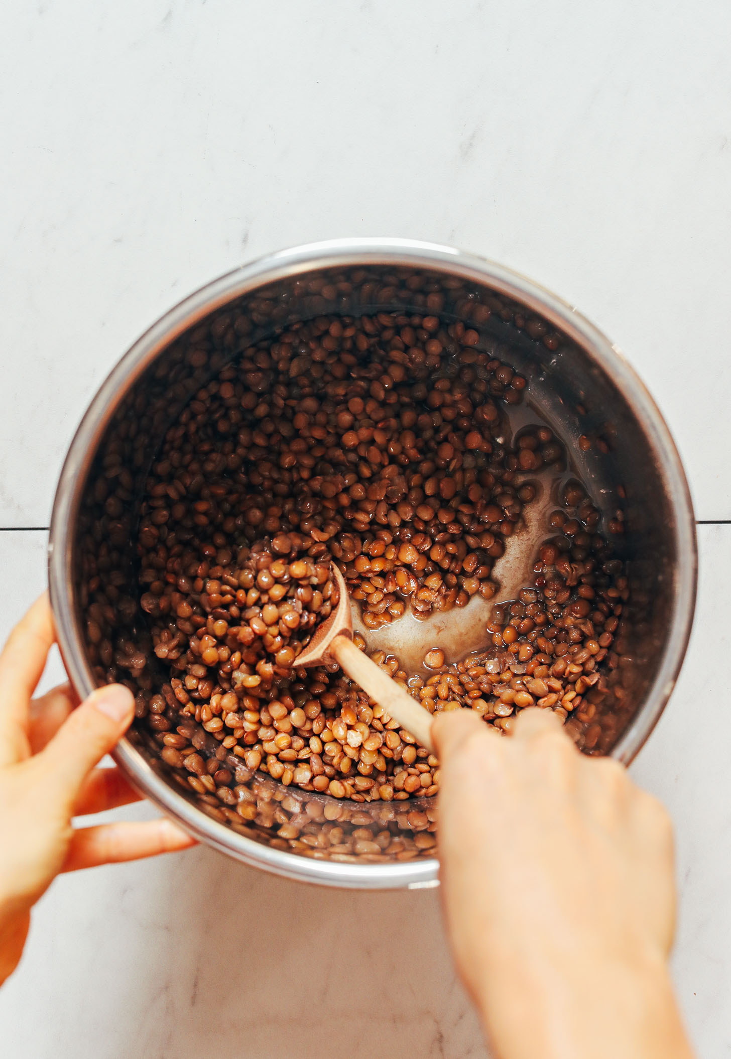 Stirring cooked lentils in the Instant Pot