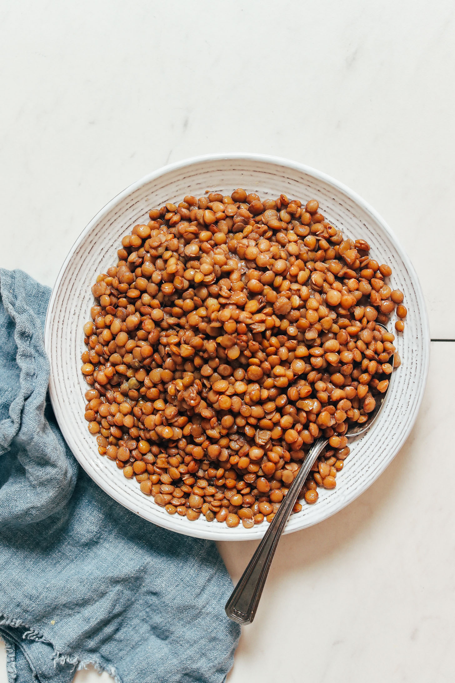 Vintage spoon in a bowl of perfectly cooked Instant Pot lentils