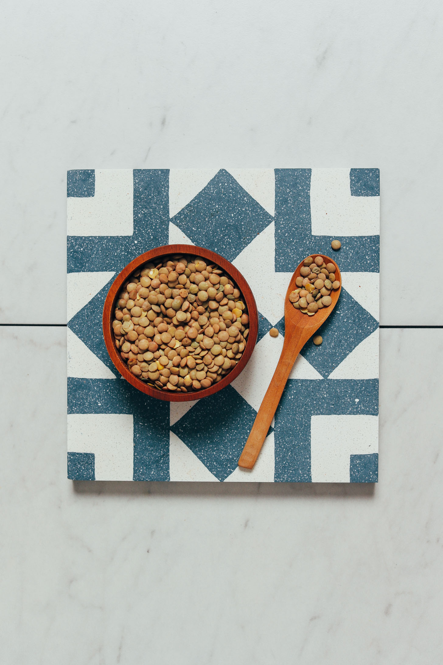 Spoonful and bowl of dried lentils