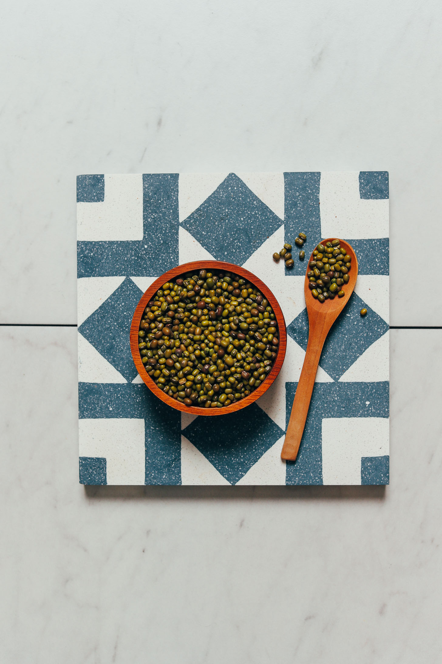 Spoonful and bowl of green mung beans