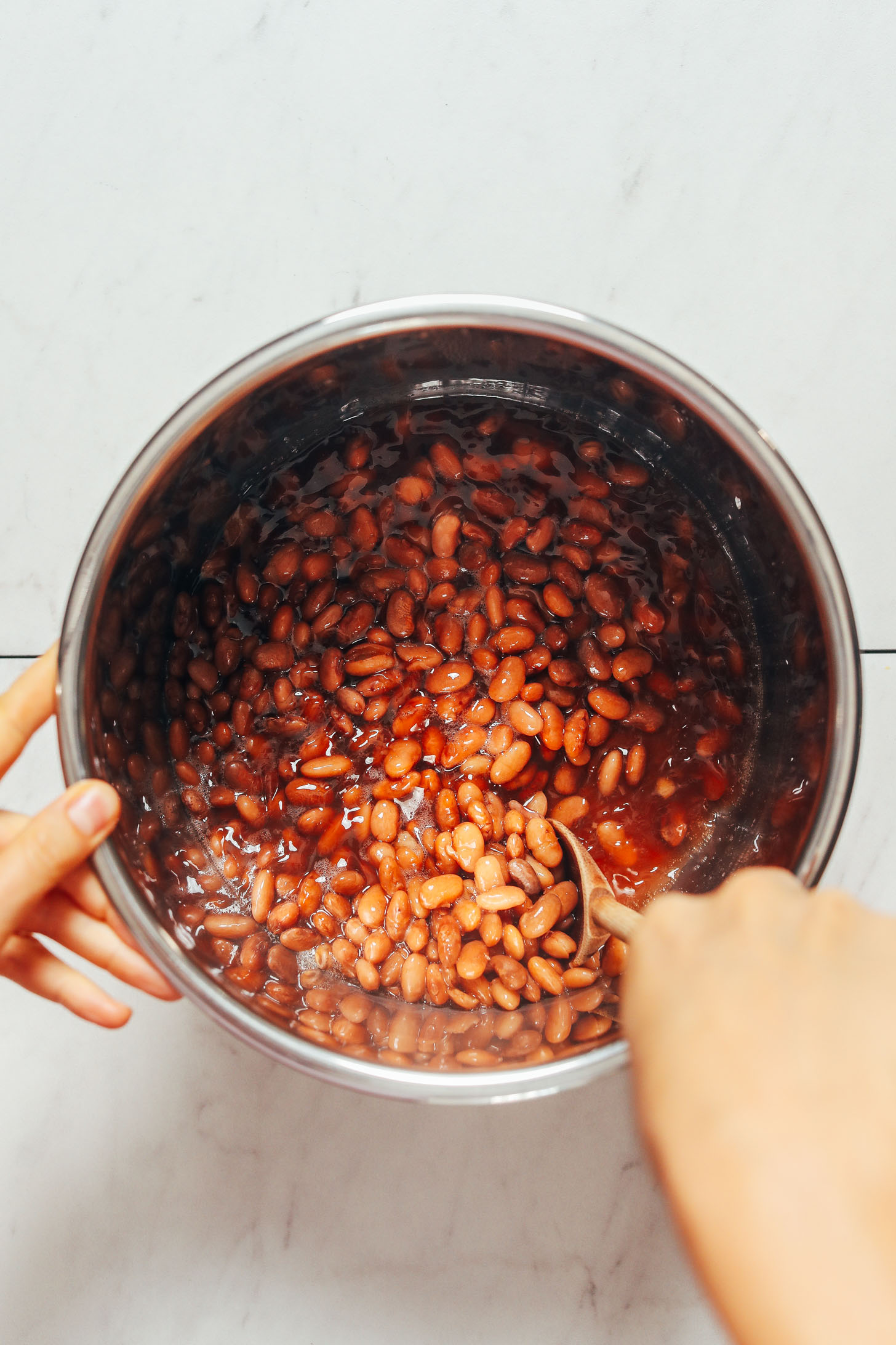 Stirring a pot of pinto beans