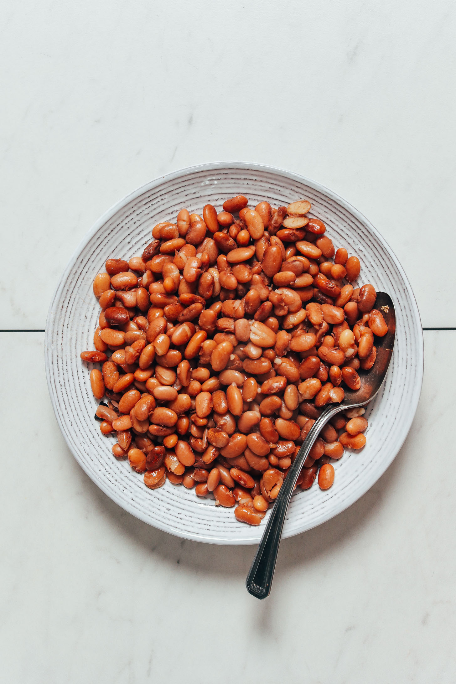 Vintage spoon in a bowl of Instant Pot pinto beans