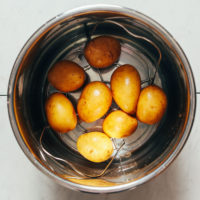 Yukon gold potatoes on a trivet in an Instant Pot