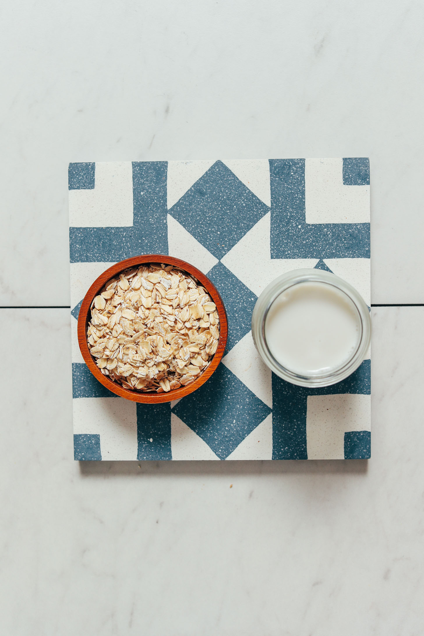 Bowl of rolled oats and glass of dairy-free milk