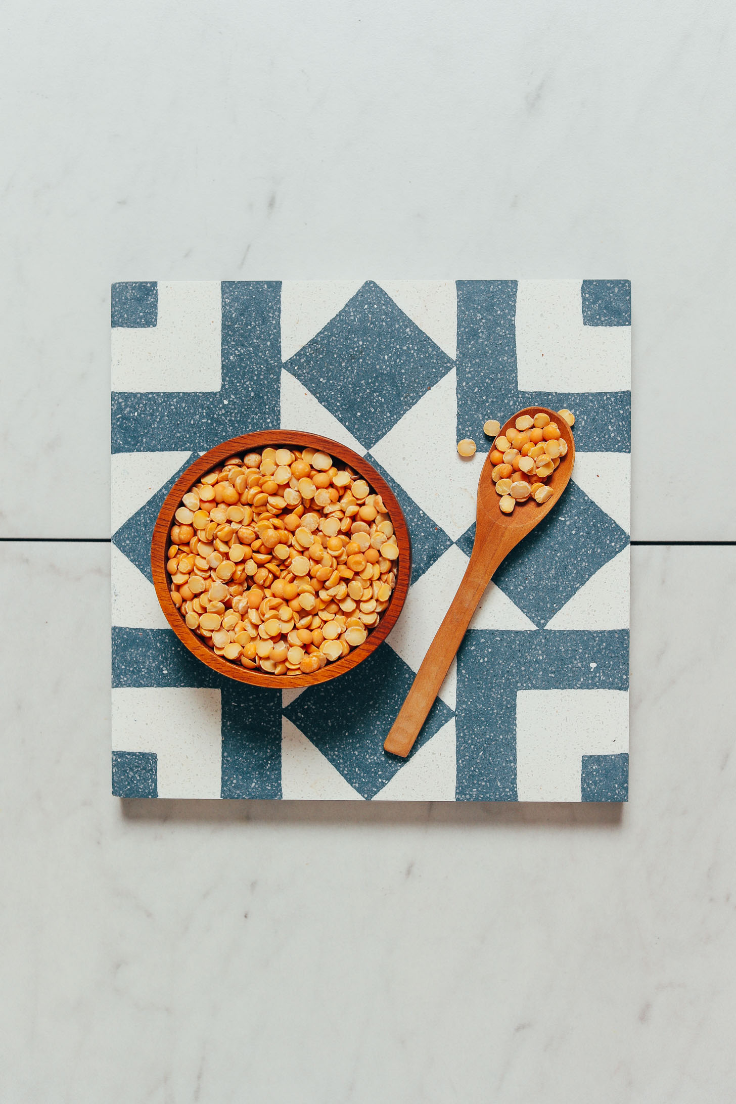 Spoon and bowl of dry yellow split peas
