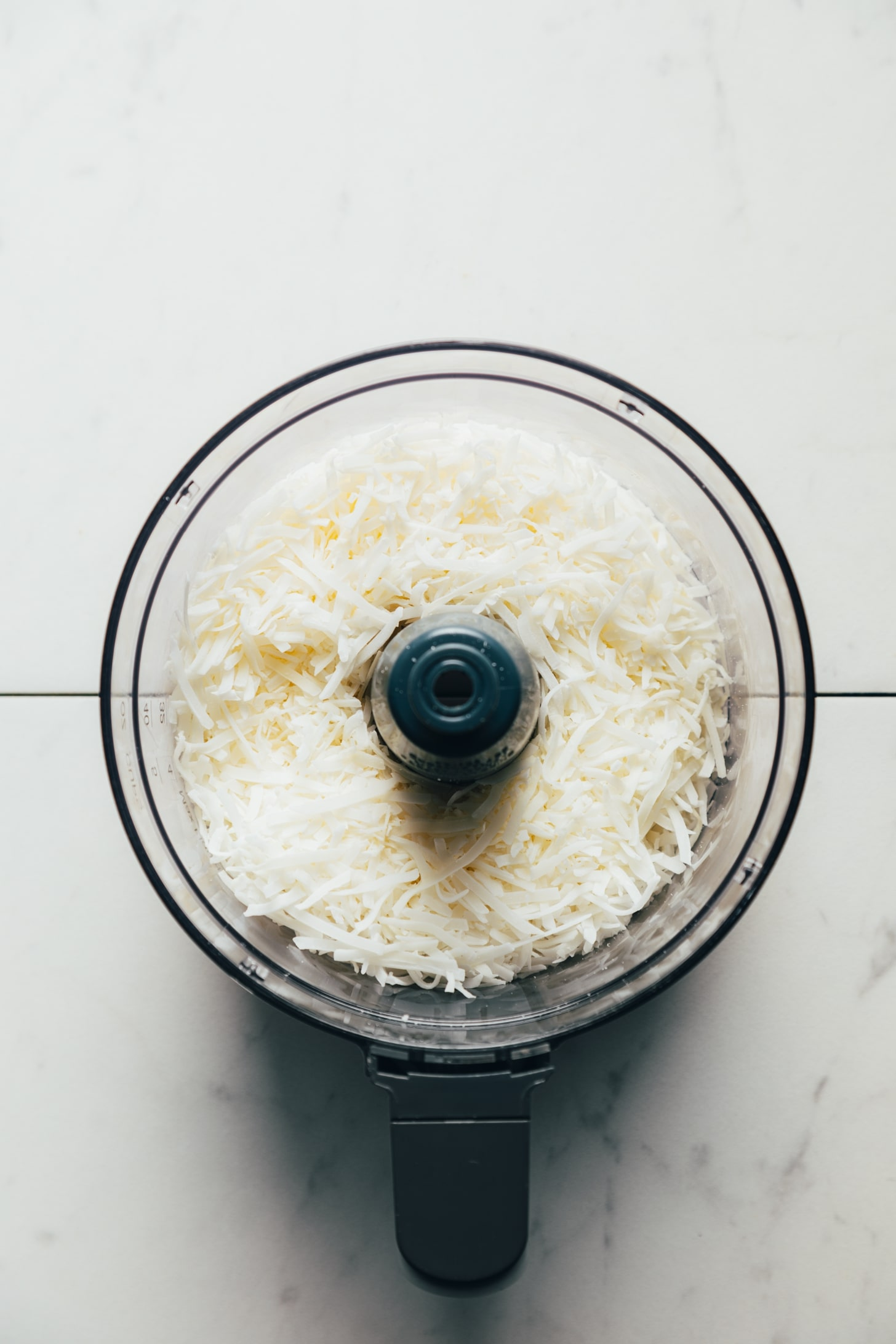 Shredded coconut in a food processor