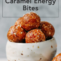 Small bowl piled high with Salted Caramel Cashew Energy Bites