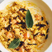 Bowl of Butternut Squash Pasta topped with sage leaves