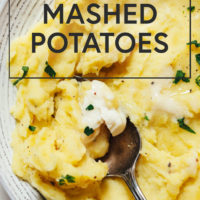 Spoon in a bowl of mashed potatoes made in the Instant Pot
