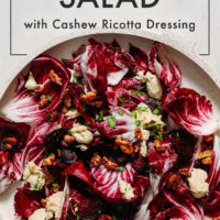 Large platter of vegan radicchio salad with candied nuts and cashew ricotta