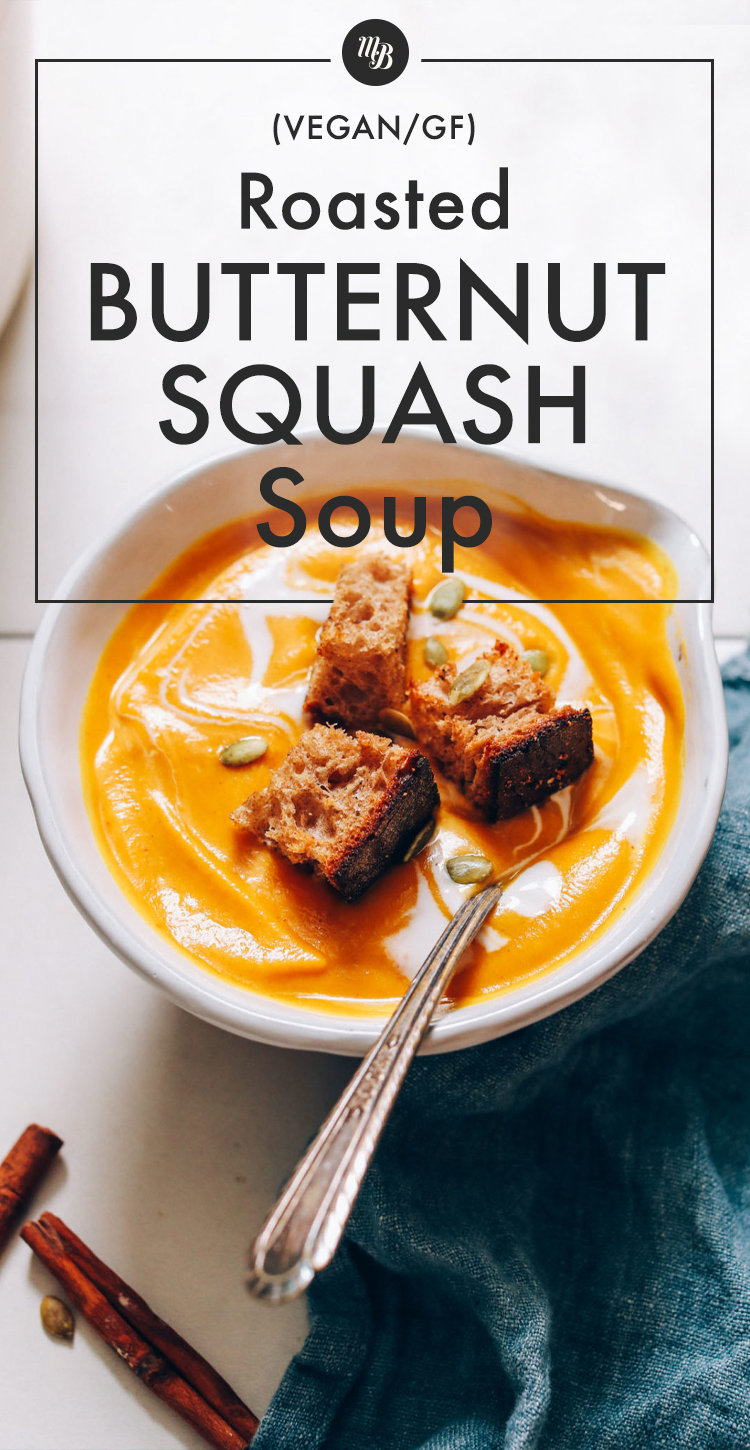 Bowl of butternut squash soup topped with croutons and homemade pepitas
