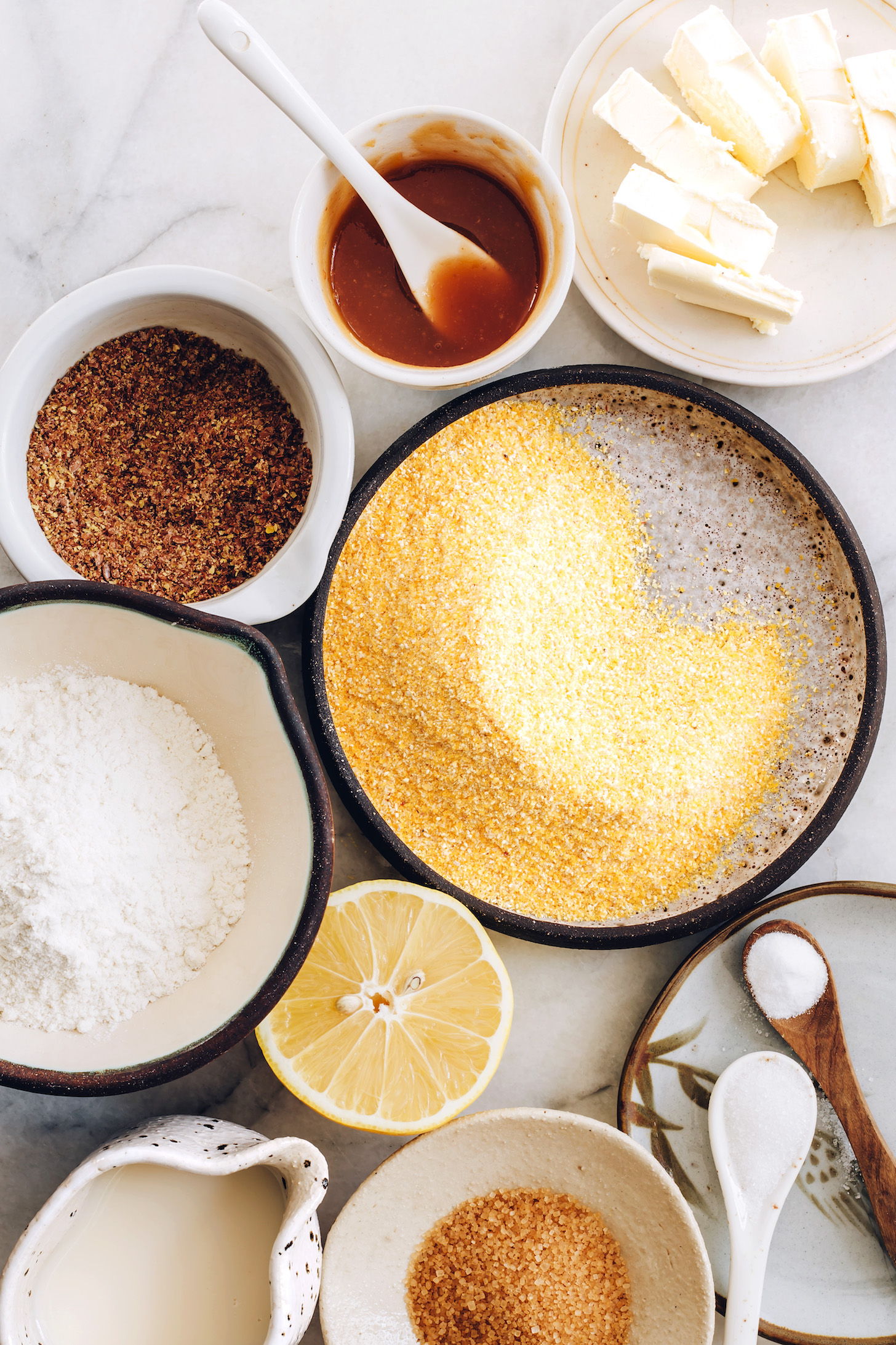 Cornmeal, flour, ground flax, lemon, almond milk, vegan butter, applesauce, salt, baking soda, and sugar