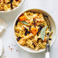 Bowl of gluten-free butternut squash pasta with shiitake bacon