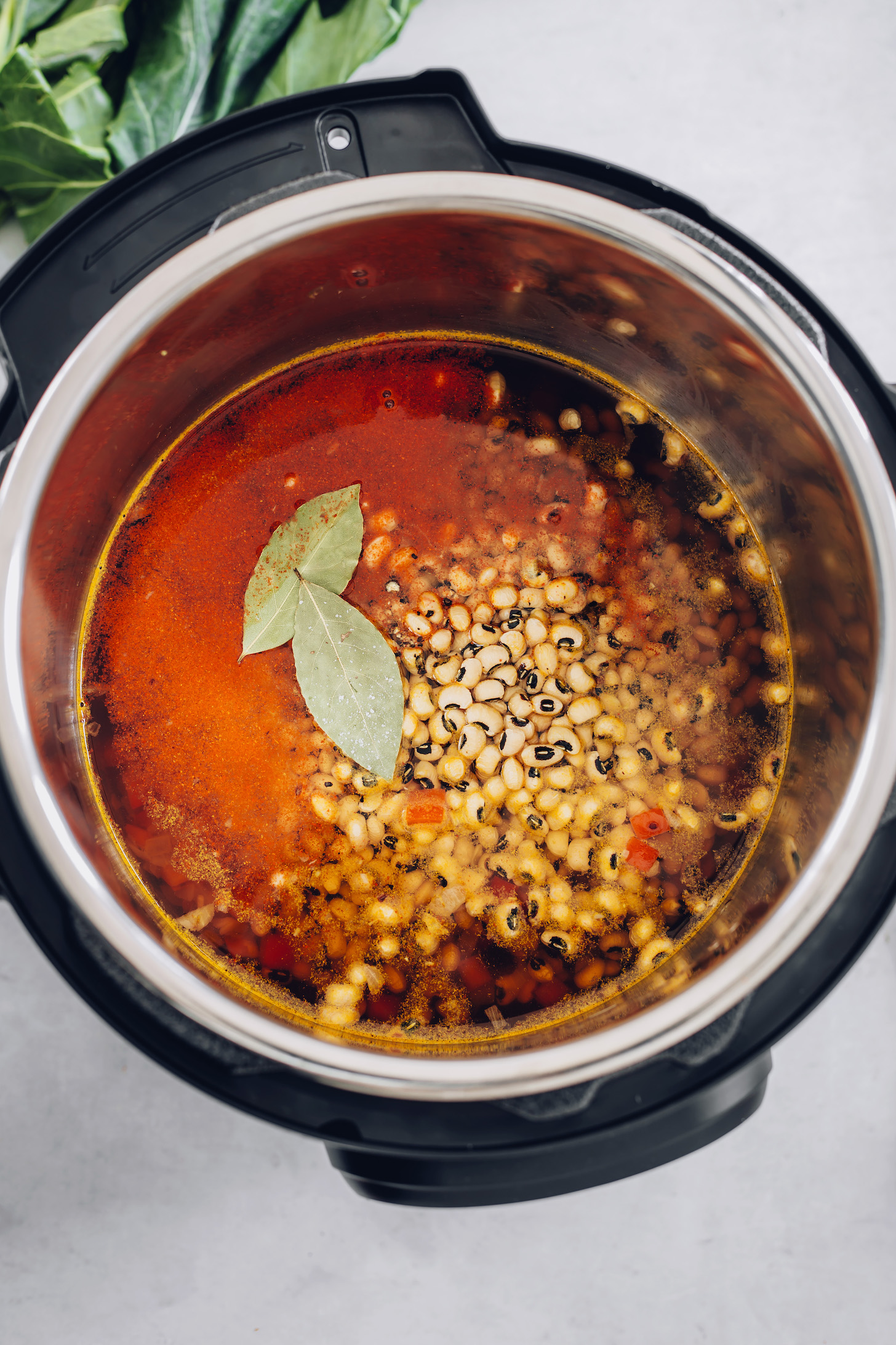 Instant Pot with black eyed peas, broth, and seasonings