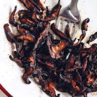 Fork on a plate of Crispy Shiitake Bacon