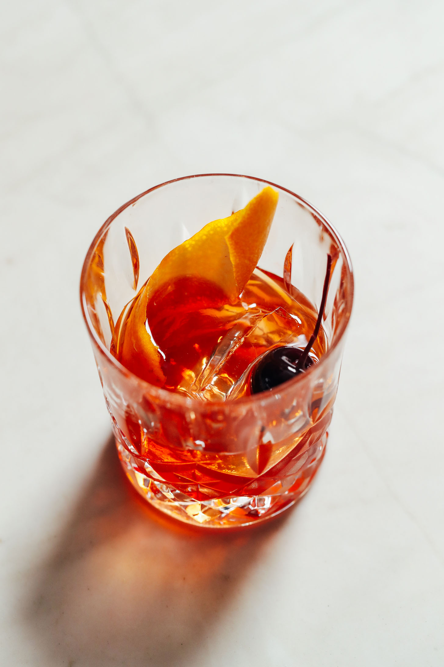 Orange peel and cocktail cherry in a Classic Old Fashioned