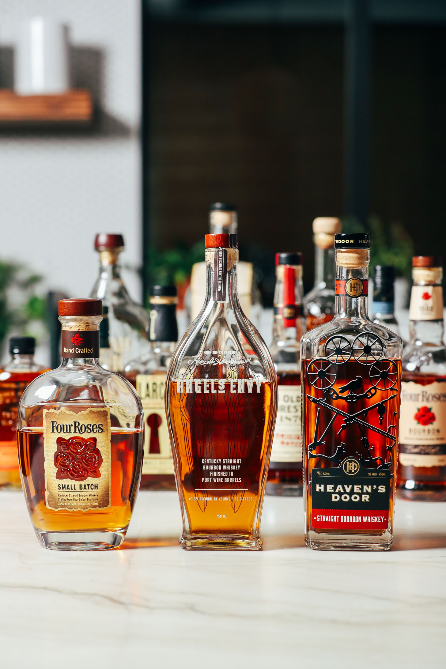 Assortment of bourbon bottles we compared for making an Old Fashioned